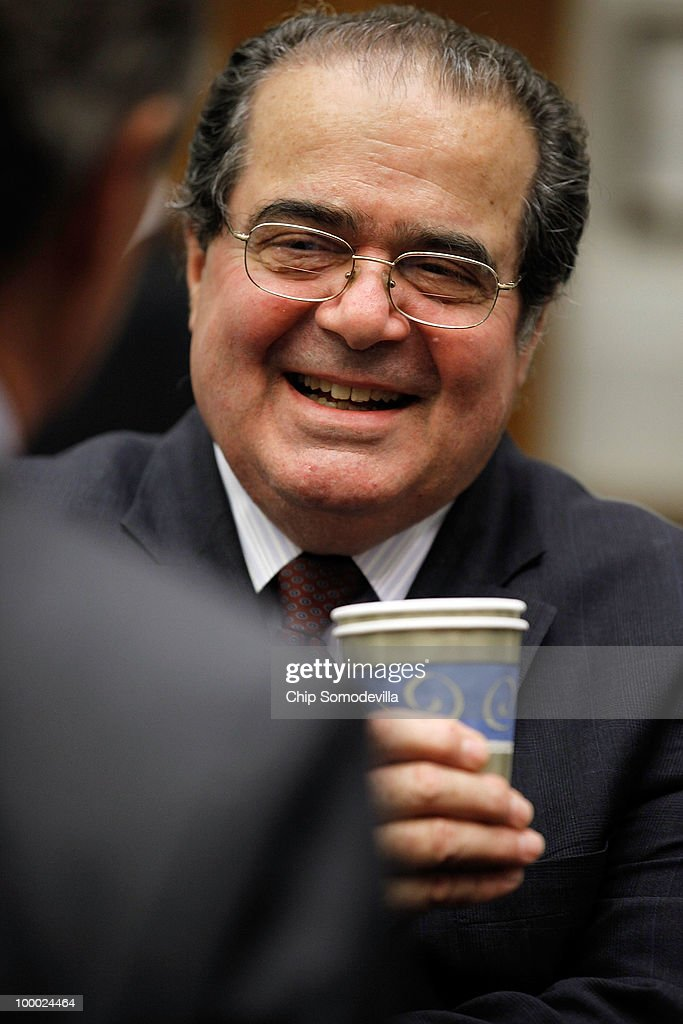 U.S. Supreme Court Associate Justice <a gi-track='captionPersonalityLinkClicked' href=/galleries/search?phrase=Antonin+Scalia&family=editorial&specificpeople=215620 ng-click='$event.stopPropagation()'>Antonin Scalia</a> prepares to testifiy before the House Judiciary Committee's Commercial and Administrative Law Subcommittee on Capitol Hill May 20, 2010 in Washington, DC. Scalia and fellow Associate Justice Stephen Breyer testified to the subcommittee about the Administrative Conference of the United States.