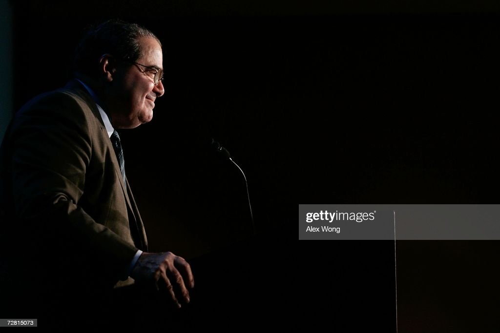 U.S. Supreme Court Associate Justice <a gi-track='captionPersonalityLinkClicked' href=/galleries/search?phrase=Antonin+Scalia&family=editorial&specificpeople=215620 ng-click='$event.stopPropagation()'>Antonin Scalia</a> smiles as he addresses a Northern Virginia Technology Council (NVTC) breakfast December 13, 2006 in McLean, Virginia. Scalia spoke to executives from technology companies in the region about constitutional interpretation.