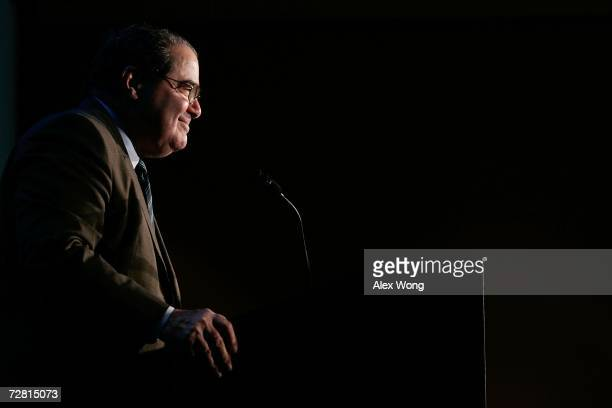 S Supreme Court Associate Justice Antonin Scalia smiles as he addresses a Northern Virginia Technology Council breakfast December 13 2006 in McLean...