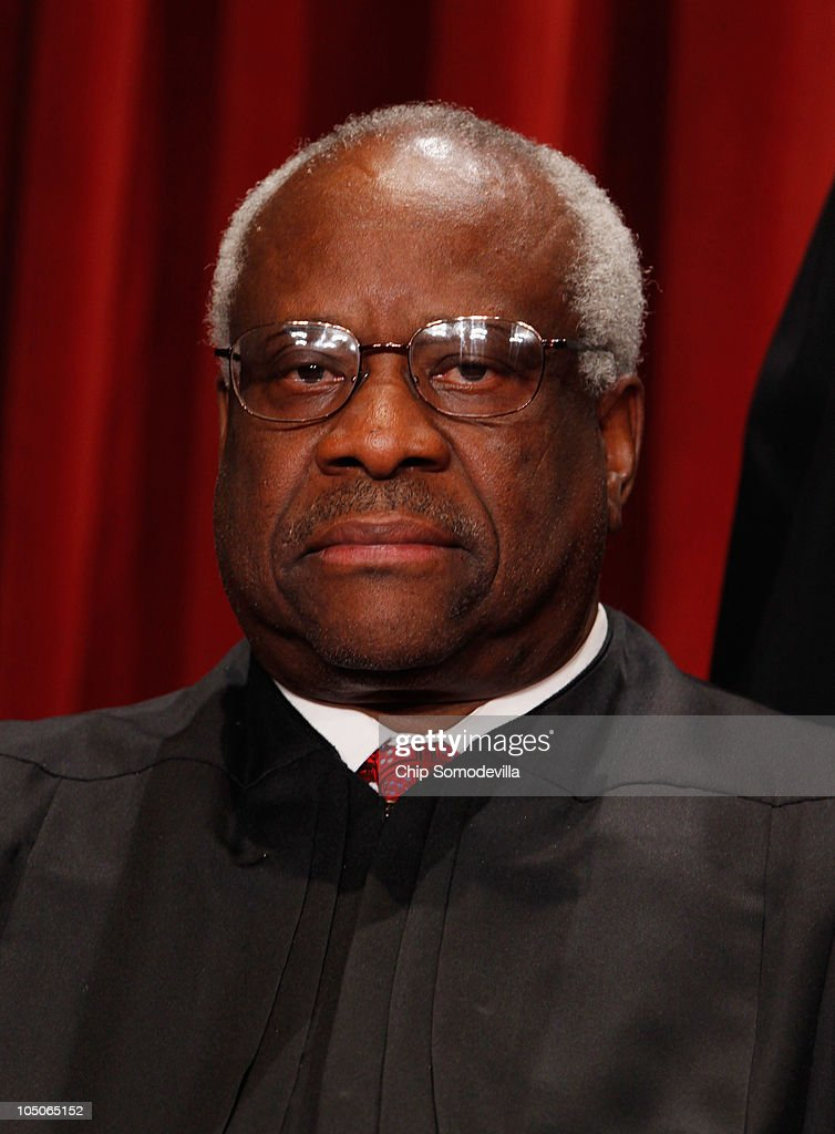 U.S. Supreme Court Associate Justice <a gi-track='captionPersonalityLinkClicked' href=/galleries/search?phrase=Clarence+Thomas+-+Judge&family=editorial&specificpeople=217528 ng-click='$event.stopPropagation()'>Clarence Thomas</a> poses for photographs in the East Conference Room at the Supreme Court building October 8, 2010 in Washington, DC. This is the first time in history that three women are simultaneously serving on the court.