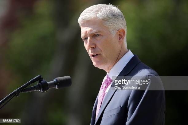 S Supreme Court Associate Justice Neil Gorsuch delivers remarks after taking the judicial oath during a ceremony in the Rose Garden at the White...
