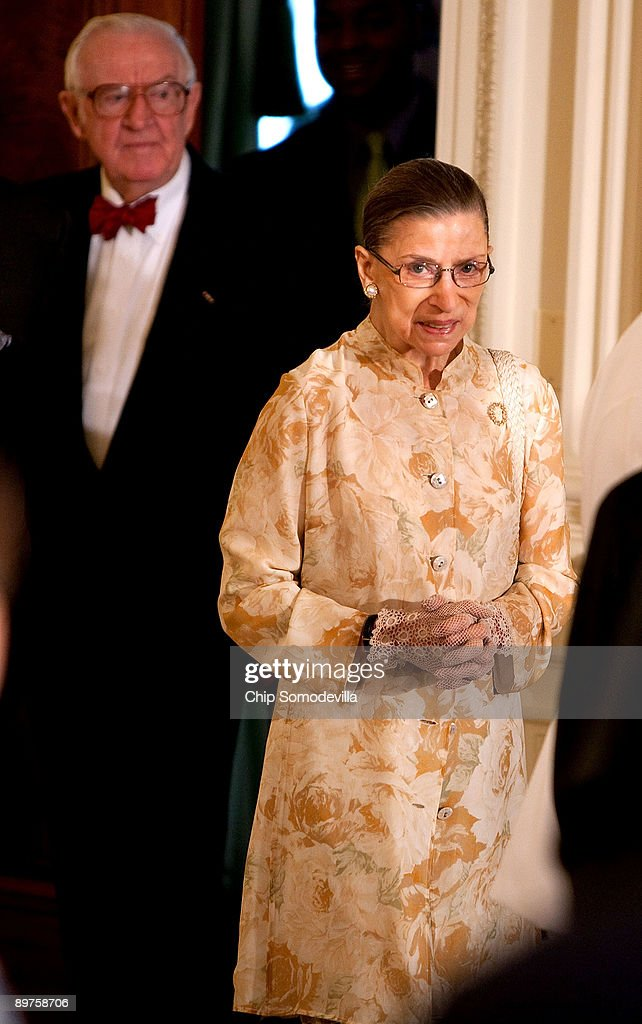 U.S. Supreme Court Associate Justice <a gi-track='captionPersonalityLinkClicked' href=/galleries/search?phrase=Ruth+Bader+Ginsburg&family=editorial&specificpeople=199152 ng-click='$event.stopPropagation()'>Ruth Bader Ginsburg</a> (R) and Associate Justice John Paul Stevens arrive for a reception in honor of new Supreme Court Associate Justice Sonia Sotomayor in the East Room of the White House August 12, 2009 in Washington, DC. Sotomayor, who is the first Hispanic and the third woman to be appointed to the Supreme Court, is expected to begin hearing oral arguments with the other justices in September.