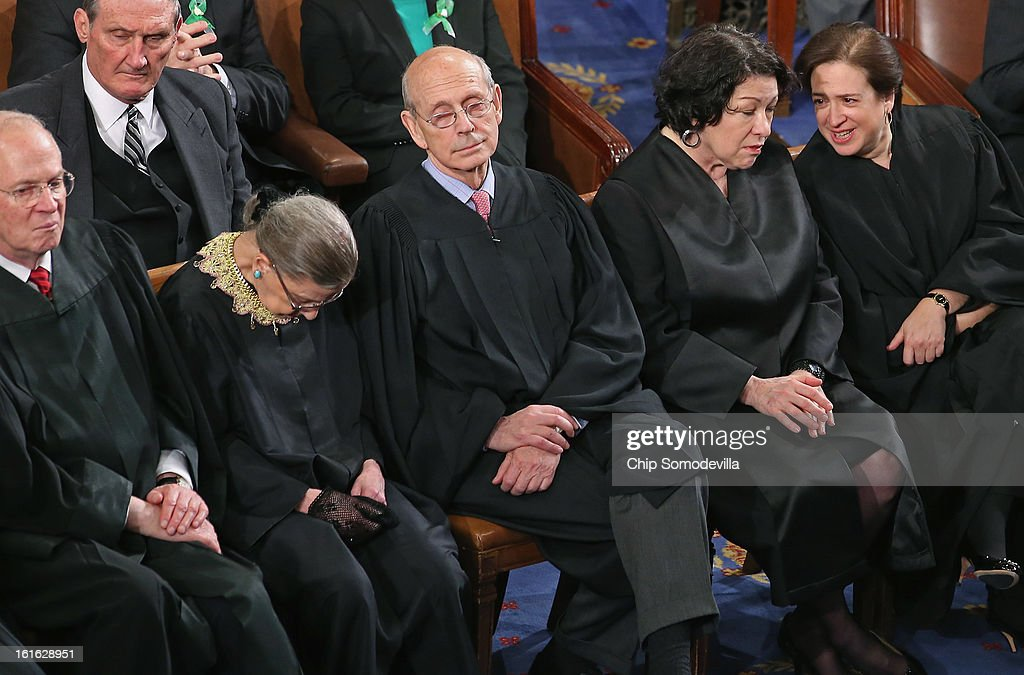 Supreme Court associate justices (L-R) Anthony Kennendy, Ruth Bader Ginsburg, John Paul Stevens, Sonia Sotomayor and Elena Kagan attend U.S. President Barack Obama's State of the Union speech before a joint session of Congress at the U.S. Capitol February 12, 2013 in Washington, DC. Facing a divided Congress, Obama focused his speech on new initiatives designed to stimulate the U.S. economy and said, 'It?s not a bigger government we need, but a smarter government that sets priorities and invests in broad-based growth'.