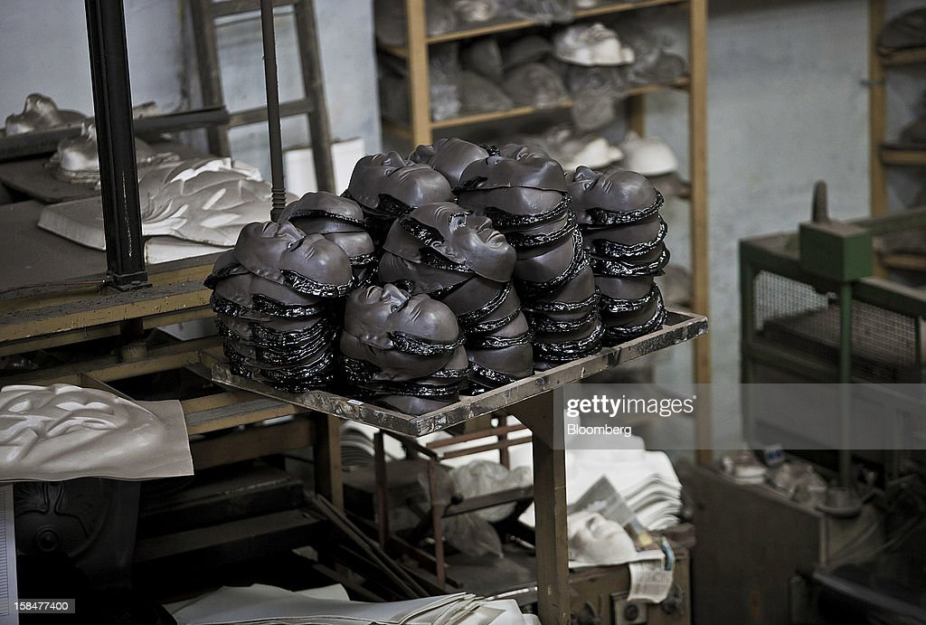 Supreme Court Chief Justice Joaquim Barbosa masks sit stacked at the Mascaras Condal factory in Sao Goncalo, Brazil, on Monday, Dec. 17, 2012. In a uniquely Brazilian measure of star status, Barbosa masks will be among the most popular during the Carnival celebration in February, according to Rio de Janeiro's O Globo newspaper. Photographer: Dado Galdieri/Bloomberg via Getty Images