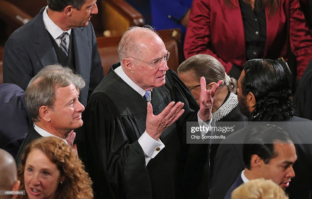 U.S. Supreme Court Chief Justice <a gi-track='captionPersonalityLinkClicked' href=/galleries/search?phrase=John+Roberts+-+17th+Chief+Justice+of+the+United+States&family=editorial&specificpeople=2220360 ng-click='$event.stopPropagation()'>John Roberts</a> (L) and Associate Justice <a gi-track='captionPersonalityLinkClicked' href=/galleries/search?phrase=Anthony+Kennedy+-+Judge&family=editorial&specificpeople=220874 ng-click='$event.stopPropagation()'>Anthony Kennedy</a> (C) visit with memebrs of Congress after Pope Francis addressed a joint meeting in the House Chamber of the U.S. Capitol September 24, 2015 in Washington, DC. Pope Francis is the first pope to address a joint meeting of Congress and will finish his tour of Washington later today before traveling to New York City.