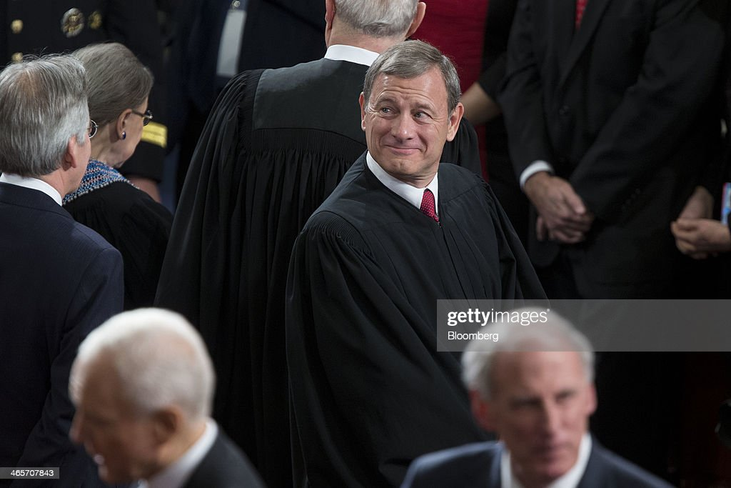 Supreme Court Chief Justice <a gi-track='captionPersonalityLinkClicked' href=/galleries/search?phrase=John+Roberts+-+17th+Chief+Justice+of+the+United+States&family=editorial&specificpeople=2220360 ng-click='$event.stopPropagation()'>John Roberts</a> arrives to listen to U.S. President Barack Obama, not pictured, deliver the State of the Union address to a joint session of Congress at the Capitol in Washington, D.C., U.S., on Tuesday, Jan. 28, 2014. Obama offered modest steps to chip away at the country's economic and social challenges in a State of the Union address that reflects the limits of his power to sway Congress. Photographer: Andrew Harrer/Bloomberg via Getty Images