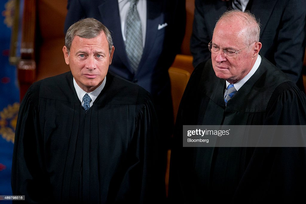 Supreme Court Chief Justice <a gi-track='captionPersonalityLinkClicked' href=/galleries/search?phrase=John+Roberts+-+17th+Chief+Justice+of+the+United+States&family=editorial&specificpeople=2220360 ng-click='$event.stopPropagation()'>John Roberts</a>, left, and <a gi-track='captionPersonalityLinkClicked' href=/galleries/search?phrase=Anthony+Kennedy+-+Judge&family=editorial&specificpeople=220874 ng-click='$event.stopPropagation()'>Anthony Kennedy</a>, associate justice of the Supreme Court, talk before listening to Pope Francis, not pictured, speak to a joint meeting of Congress in the House Chamber at the U.S. Capitol in Washington, D.C., U.S., on Thursday, Sept. 24, 2015. Pope Francis, the first pontiff to address U.S. Congress, is preaching to a less-than-harmonious congregation as he faces a Congress riven by disputes over issues closest to his heart: income inequality, immigration and climate change. Photographer: Andrew Harrer/Bloomberg via Getty Images