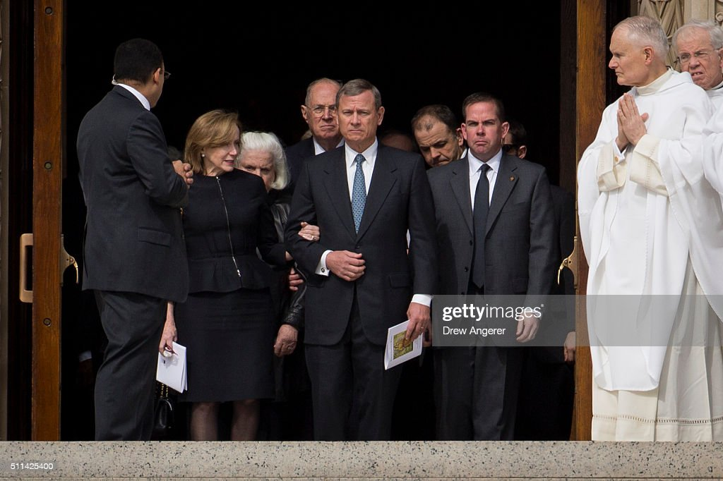 Supreme Court Chief Justice John Roberts locks arms with his wife Jane Sullivan Roberts as they prepare to walk down the steps of the Basilica of the...