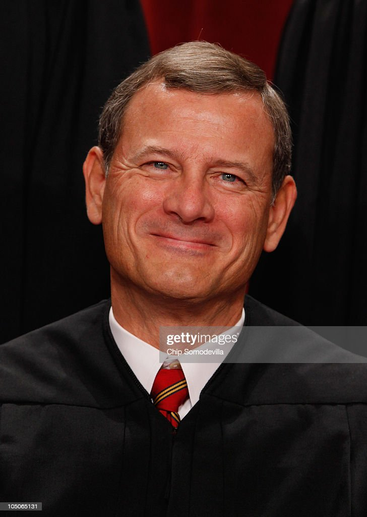 U.S. Supreme Court Chief Justice John Roberts poses for photographs in the East Conference Room at the Supreme Court building October 8, 2010 in Washington, DC. This is the first time in history that three women are simultaneously serving on the court.