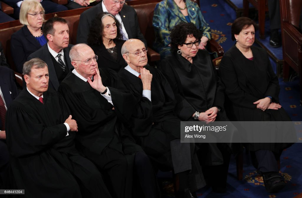 Supreme Court Chief Justice John Roberts, Supreme Court Associate Justice Anthony Kennedy, Supreme Court Associate Justice Stephen Breyer, Supreme Court Associate Justice Sonia Sotomayor and Supreme Court Associate Justice Elena Kagan look on as U.S. President Donald Trump addresses a joint session of the U.S. Congress on February 28, 2017 in the House chamber of the U.S. Capitol in Washington, DC. Trump's first address to Congress focused on national security, tax and regulatory reform, the economy, and healthcare.