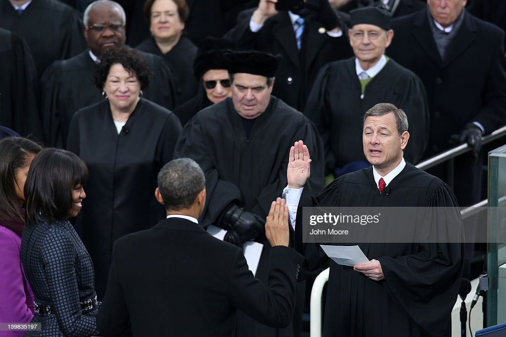 Supreme Court Chief Justice John Roberts swears in US President Barack Obama during the public ceremonial inauguration as first lady Michelle Obama...