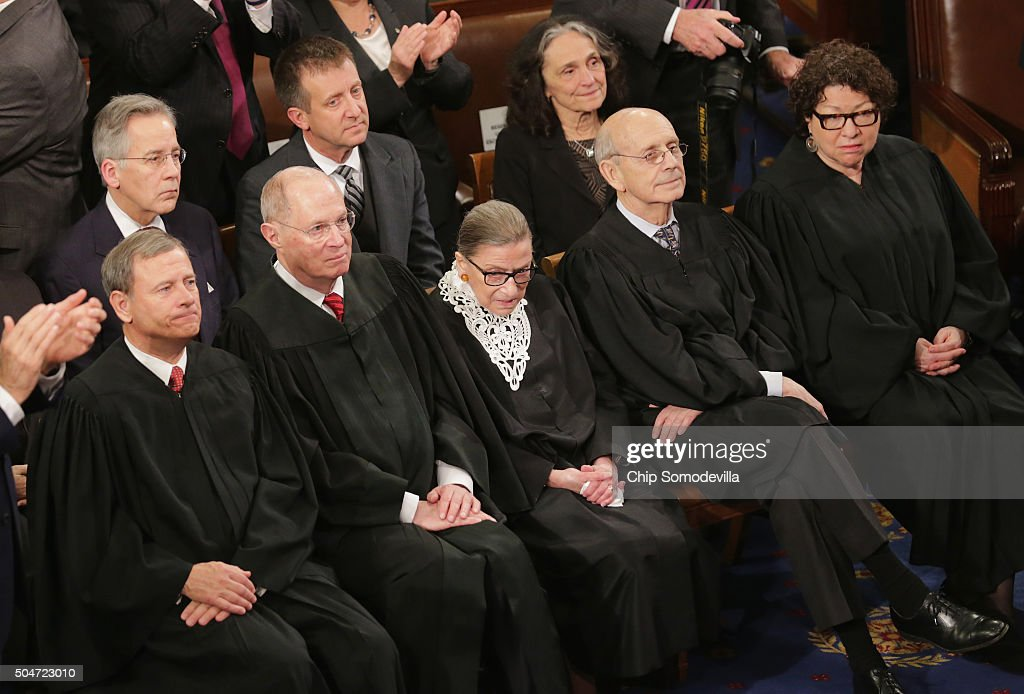 U.S. Supreme Court Chief Justice <a gi-track='captionPersonalityLinkClicked' href=/galleries/search?phrase=John+Roberts+-+17th+Chief+Justice+of+the+United+States&family=editorial&specificpeople=2220360 ng-click='$event.stopPropagation()'>John Roberts</a>, U.S. Supreme Court Associate Justice <a gi-track='captionPersonalityLinkClicked' href=/galleries/search?phrase=Anthony+Kennedy+-+Judge&family=editorial&specificpeople=220874 ng-click='$event.stopPropagation()'>Anthony Kennedy</a>, U.S. Supreme Court Associate Justice <a gi-track='captionPersonalityLinkClicked' href=/galleries/search?phrase=Ruth+Bader+Ginsburg&family=editorial&specificpeople=199152 ng-click='$event.stopPropagation()'>Ruth Bader Ginsburg</a>, U.S. Supreme Court Associate Justice Stephen Breyer, and U.S. Supreme Court Associate Justice <a gi-track='captionPersonalityLinkClicked' href=/galleries/search?phrase=Sonia+Sotomayor&family=editorial&specificpeople=5872777 ng-click='$event.stopPropagation()'>Sonia Sotomayor</a> listen to US President Barack Obama deliver the State of the Union speech before members of Congress in the House chamber of the U.S. Capitol January 12, 2016 in Washington, DC. In his last State of the Union, President Obama reflected on the past seven years in office and spoke on topics including climate change, gun control, immigration and income inequality.