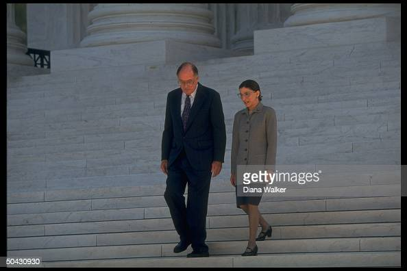 Supreme Court Chief Justice William Rehnquist escorting Ruth Bader Ginsburg down steps of Supreme Court bldg after newest associate justice took her...