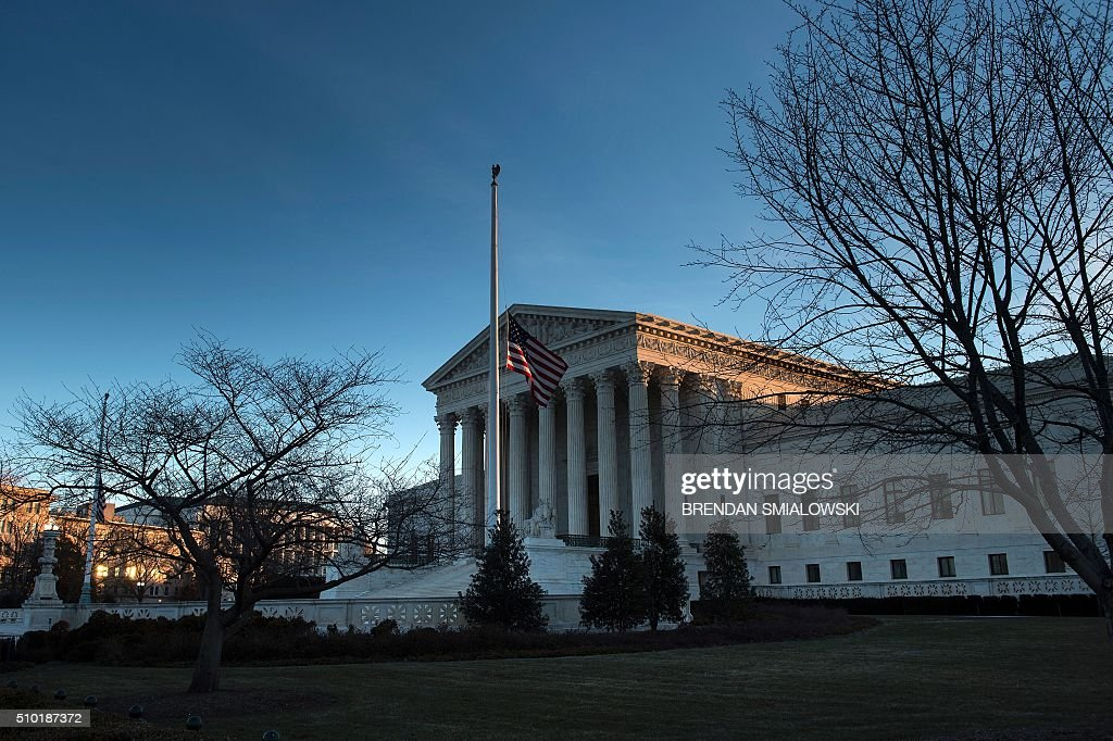 US Supreme Court is seen on February 14, 2016 in Washington. Justice Antonin Scalia, a towering conservative voice on the US Supreme Court, has died at the age of 79, triggering a political showdown over his succession in the run-up to the presidential election. President Barack Obama ordered flags to fly at half-staff across the United States until the long-serving justice, first appointed by Ronald Reagan in 1986, is laid to rest. / AFP / Brendan Smialowski