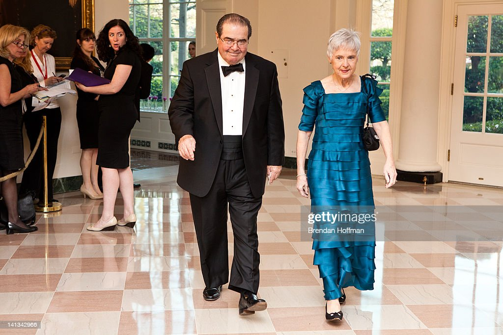 U.S. Supreme Court Justice <a gi-track='captionPersonalityLinkClicked' href=/galleries/search?phrase=Antonin+Scalia&family=editorial&specificpeople=215620 ng-click='$event.stopPropagation()'>Antonin Scalia</a> and Maureen M. Scalia (R) arrive for a State Dinner in honor of British Prime Minister David Cameron at the White House on March 14, 2012 in Washington, DC. Cameron is on a three day official visit to Washington.