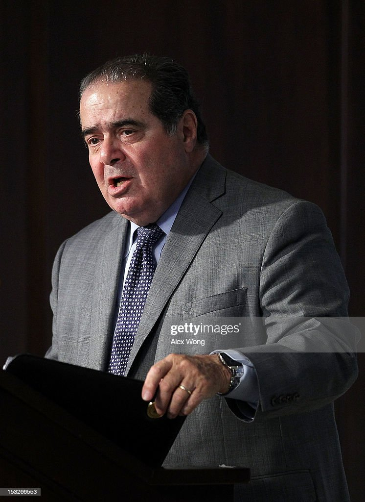 U.S. Supreme Court Justice <a gi-track='captionPersonalityLinkClicked' href=/galleries/search?phrase=Antonin+Scalia&family=editorial&specificpeople=215620 ng-click='$event.stopPropagation()'>Antonin Scalia</a> speaks at the American Enterprise Institute (AEI) October 2, 2012 in Washington, DC. The American Enterprise Institute and the Federalist Society held a book discussion with Justice Scalia, who co-authored the book 'Reading Law: The Interpretation of Legal Texts.'
