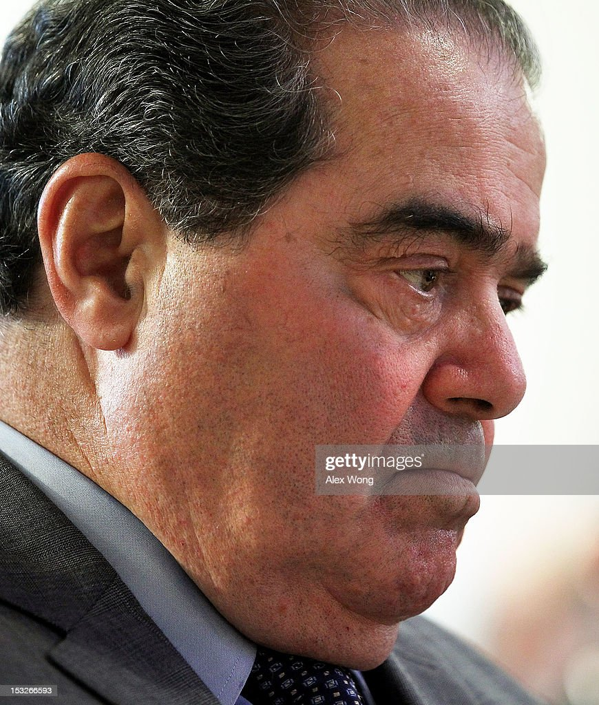 U.S. Supreme Court Justice <a gi-track='captionPersonalityLinkClicked' href=/galleries/search?phrase=Antonin+Scalia&family=editorial&specificpeople=215620 ng-click='$event.stopPropagation()'>Antonin Scalia</a> waits to be introduced to speak at the American Enterprise Institute (AEI) October 2, 2012 in Washington, DC. The American Enterprise Institute and the Federalist Society held a book discussion with Justice Scalia, who co-authored the book 'Reading Law: The Interpretation of Legal Texts.'