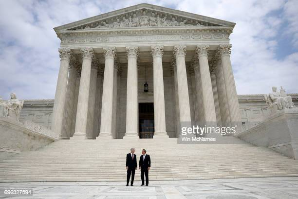 Supreme Court Justice Neil Gorsuch stands with Chief Justice John Roberts following his official investiture at the Supreme Court June 15 2017 in...