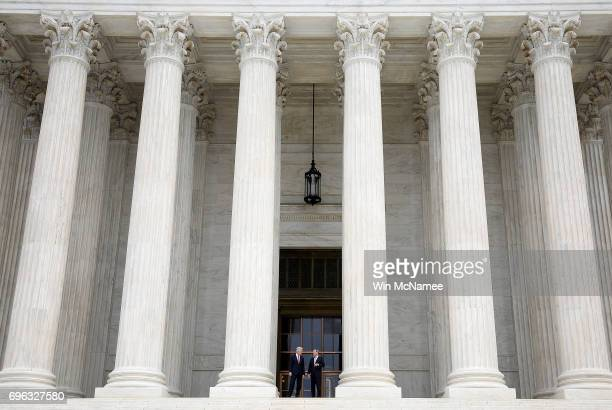 Supreme Court Justice Neil Gorsuch talks with Chief Justice John Roberts on the steps of the Supreme Court following his official investiture at the...