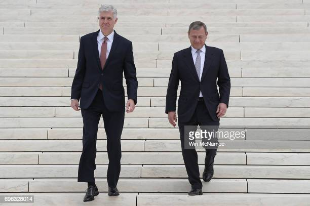 Supreme Court Justice Neil Gorsuch walks down the steps of the Supreme Court with Chief Justice John Roberts following his official investiture...