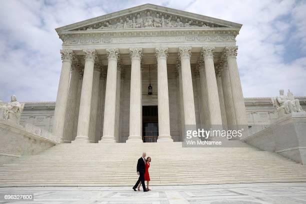 Supreme Court Justice Neil Gorsuch walks with his wife Marie Louise Gorsuch following his official investiture at the Supreme Court June 15 2017 in...