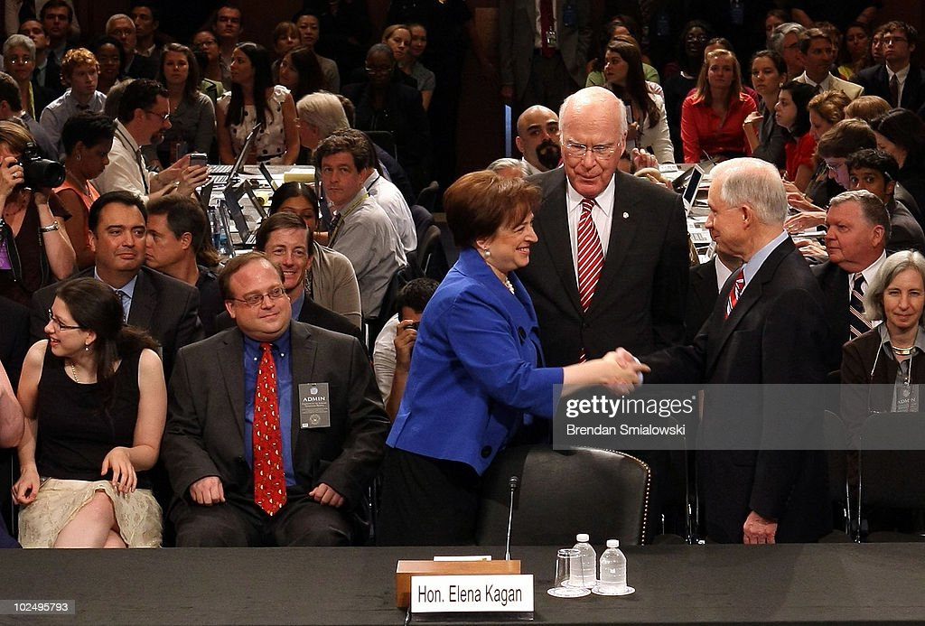 U.S. Supreme Court Justice nominee <a gi-track='captionPersonalityLinkClicked' href=/galleries/search?phrase=Elena+Kagan&family=editorial&specificpeople=5704239 ng-click='$event.stopPropagation()'>Elena Kagan</a> (L) shakes hands with Sen. <a gi-track='captionPersonalityLinkClicked' href=/galleries/search?phrase=Jeff+Sessions&family=editorial&specificpeople=534346 ng-click='$event.stopPropagation()'>Jeff Sessions</a> (R-AL) (R), ranking member of the Senate Judiciary Committee, as she arrives for the first day of her confirmation hearings with Chairman Sen. Patrick Leahy (D-VT) (C) on Capitol Hill June 28, 2010 in Washington, DC. Kagan is U.S. President Barack Obama's second Supreme Court nominee since taking office.