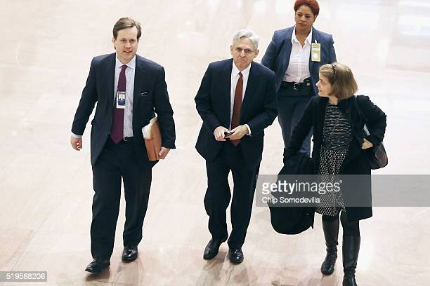 S Supreme Court Justice nominee Merrick Garland and White House Special Assistant to the President Joshua Pollack walk through the Hart Senate Office...
