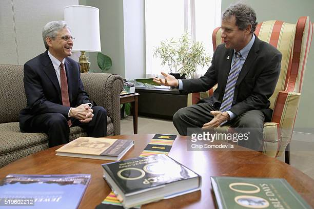 S Supreme Court Justice nominee Merrick Garland talks with Sen Sherrod Brown in his office in the Hart Senate Office Building on Capitol Hill April 7...