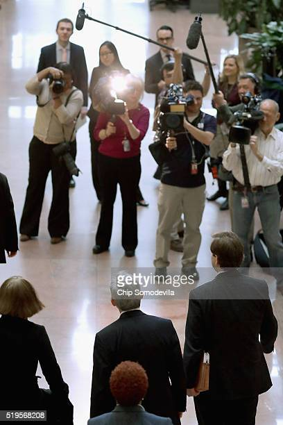 S Supreme Court Justice nominee Merrick Garland walks past a bank of television cameras before meeting with US Sen Heidi Heitkamp in Hart Senate...