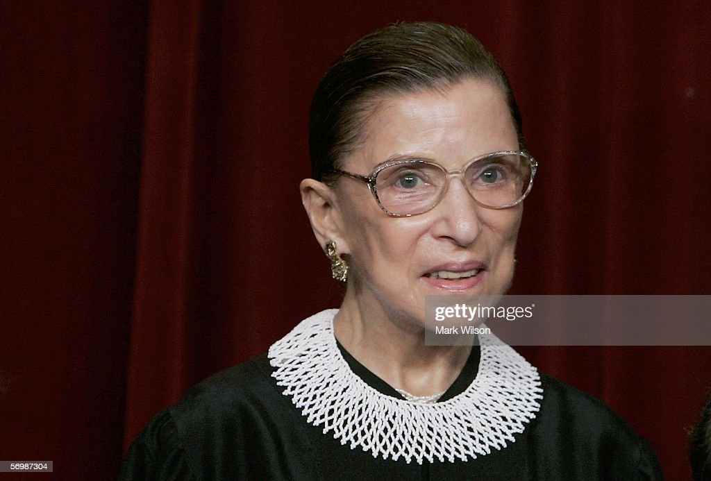 U.S. Supreme Court Justice <a gi-track='captionPersonalityLinkClicked' href=/galleries/search?phrase=Ruth+Bader+Ginsburg&family=editorial&specificpeople=199152 ng-click='$event.stopPropagation()'>Ruth Bader Ginsburg</a> smiles during a photo session with photographers at the U.S. Supreme Court March 3, 2006 in Washington DC.