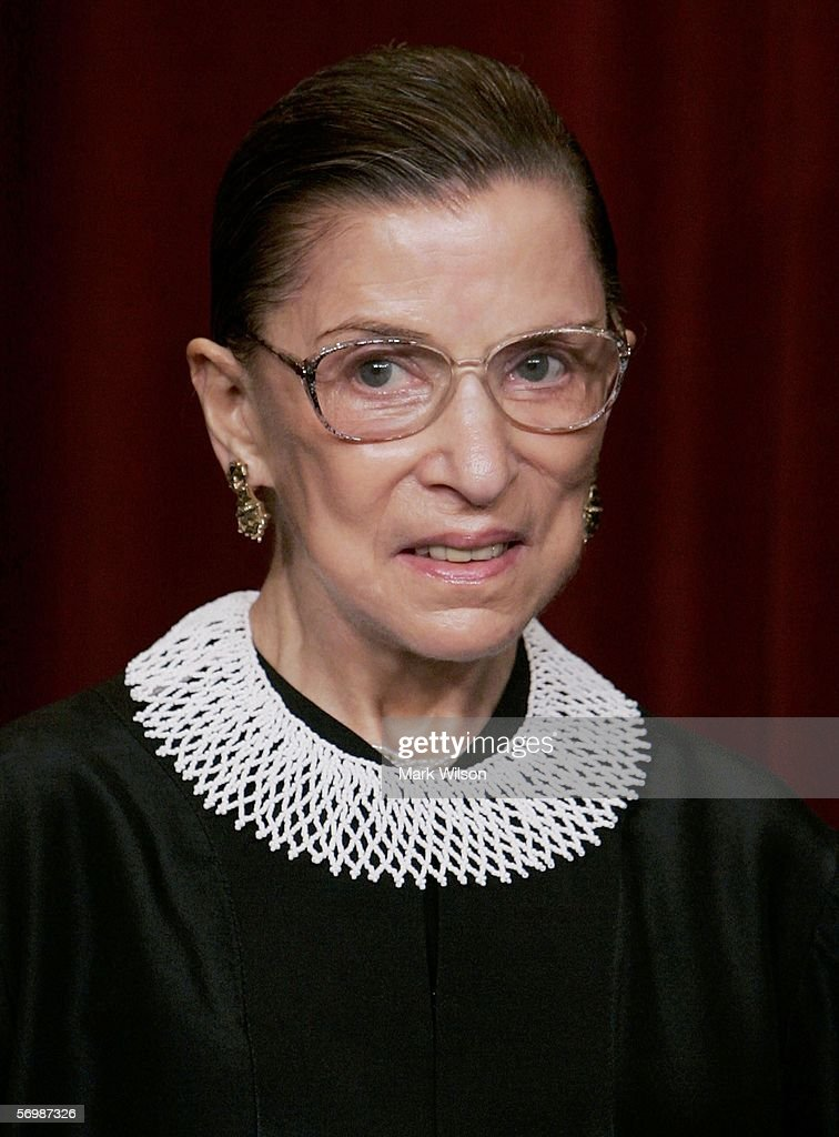 S Supreme Court Justice Ruth Bader Ginsburg smiles during a photo session with photographers at the US Supreme Court March 3 2006 in Washington DC