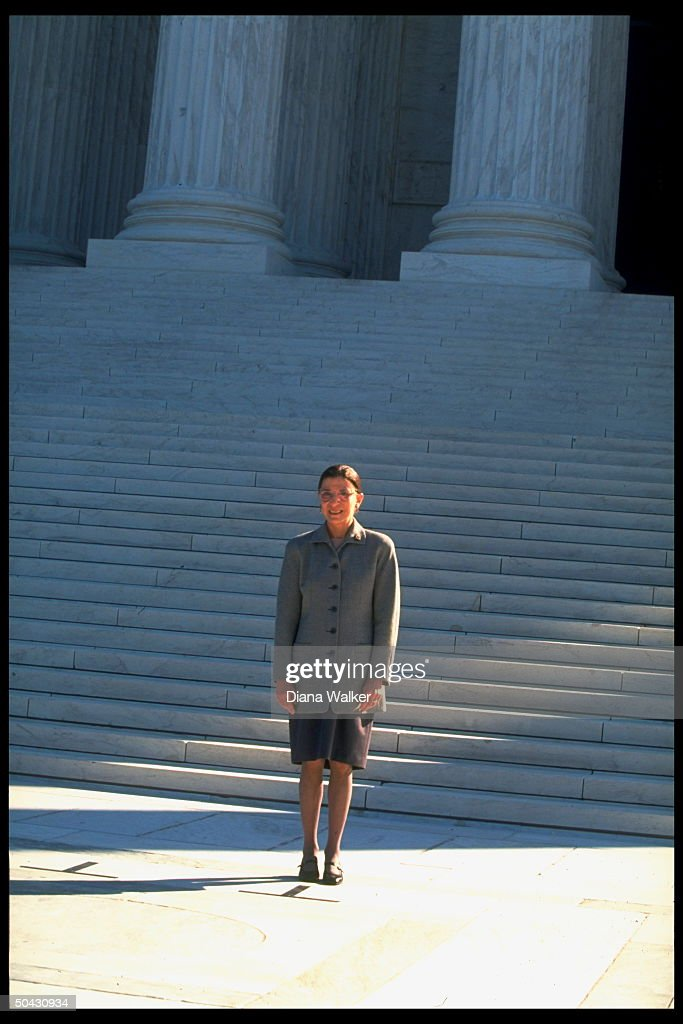 Supreme Court Justice Ruth Bader Ginsburg standing at bottom of Supreme Court bldg steps after newest associate justice took her oath