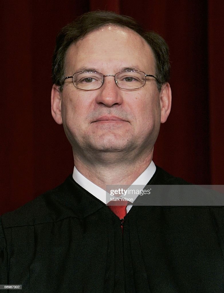 U.S. Supreme Court Justice Samuel Alito smiles during a photo session with photographers at the U.S. Supreme Court March 3, 2006 in Washington DC.