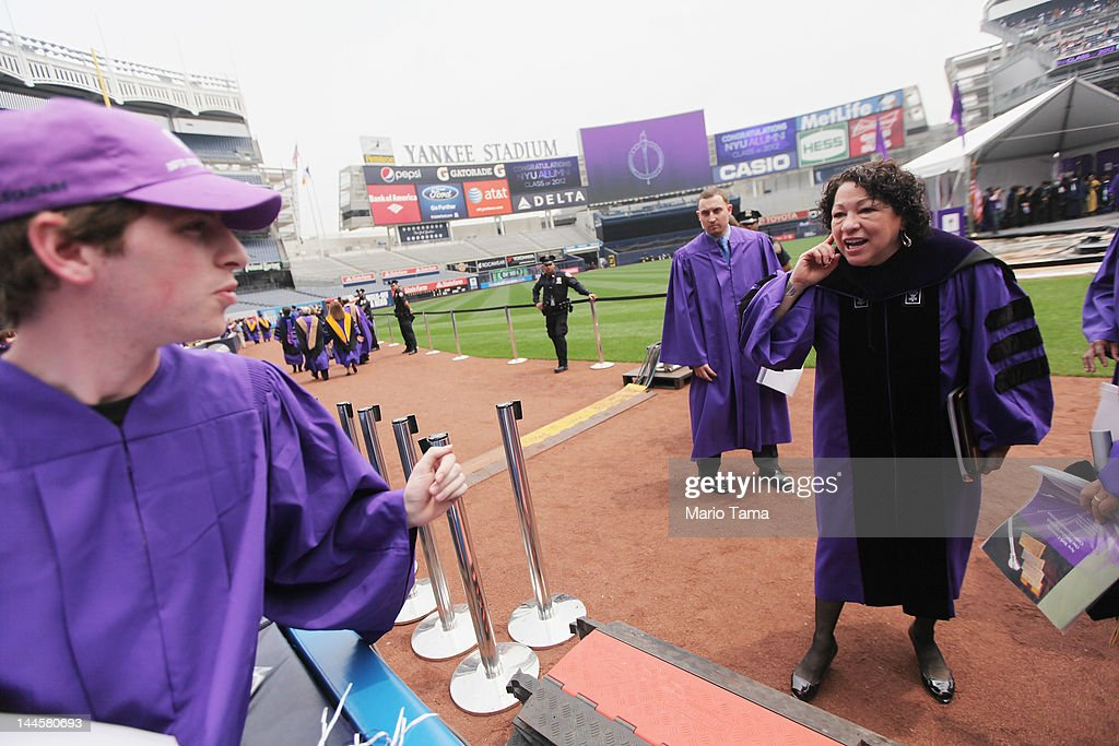 U.S. Supreme Court Justice Sonia Sotomayor (R) chats with a graduate at New York University's commencement ceremony at Yankee Stadium on May 16, 2012 in the Bronx borough of New York City. Sotomayor spoke to a crowd of more than 27,000 at the ceremony and was raised in a Bronx housing project not far from the stadium.