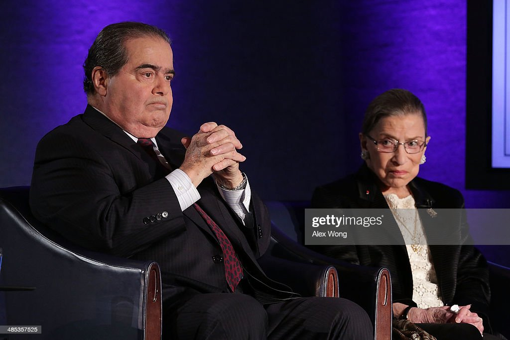 Supreme Court Justices Antonin Scalia (L) and Ruth Bader Ginsburg (R) wait for the beginning of the taping of 'The Kalb Report' April 17, 2014 at the National Press Club in Washington, DC. The Kalb Report is a discussion of media ethics and responsibility at the National Press Club held each month.