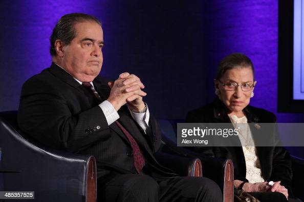 Supreme Court Justices Antonin Scalia and Ruth Bader Ginsburg wait for the beginning of the taping of 'The Kalb Report' April 17 2014 at the National...