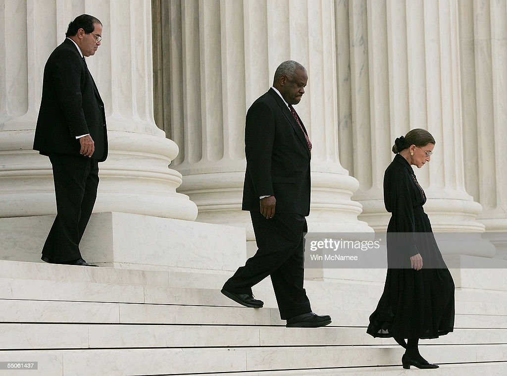 S Supreme Court Justices Antonin Scalia Clarence Thomas and Ruth Bader Ginsburg arrive for services for former US Supreme Court Chief Justice William...