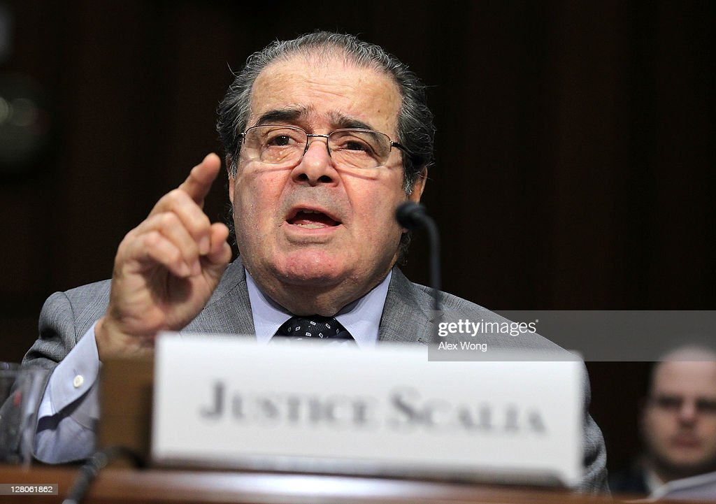 Supreme Court Justices <a gi-track='captionPersonalityLinkClicked' href=/galleries/search?phrase=Antonin+Scalia&family=editorial&specificpeople=215620 ng-click='$event.stopPropagation()'>Antonin Scalia</a> testifies during a hearing before the Senate Judiciary Committee October 5, 2011 on Capitol Hill in Washington, DC. The justice testified on 'Considering the Role of Judges Under the Constitution of the United States.'