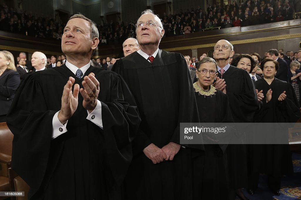 Supreme Court Justices, Chief Justice <a gi-track='captionPersonalityLinkClicked' href=/galleries/search?phrase=John+Roberts+-+17th+Chief+Justice+of+the+United+States&family=editorial&specificpeople=2220360 ng-click='$event.stopPropagation()'>John Roberts</a>, <a gi-track='captionPersonalityLinkClicked' href=/galleries/search?phrase=Anthony+Kennedy+-+Judge&family=editorial&specificpeople=220874 ng-click='$event.stopPropagation()'>Anthony Kennedy</a>, <a gi-track='captionPersonalityLinkClicked' href=/galleries/search?phrase=Ruth+Bader+Ginsburg&family=editorial&specificpeople=199152 ng-click='$event.stopPropagation()'>Ruth Bader Ginsburg</a>, <a gi-track='captionPersonalityLinkClicked' href=/galleries/search?phrase=Stephen+Breyer+-+Judge&family=editorial&specificpeople=227411 ng-click='$event.stopPropagation()'>Stephen Breyer</a>, <a gi-track='captionPersonalityLinkClicked' href=/galleries/search?phrase=Sonia+Sotomayor&family=editorial&specificpeople=5872777 ng-click='$event.stopPropagation()'>Sonia Sotomayor</a> and <a gi-track='captionPersonalityLinkClicked' href=/galleries/search?phrase=Elena+Kagan&family=editorial&specificpeople=5704239 ng-click='$event.stopPropagation()'>Elena Kagan</a> applaud before President Barack Obama's State of the Union address during a joint session of Congress on February 12, 2013 in Washington, D.C. Facing a divided Congress, Obama is expected to focus his speech on new initiatives designed to stimulate the U.S. economy.