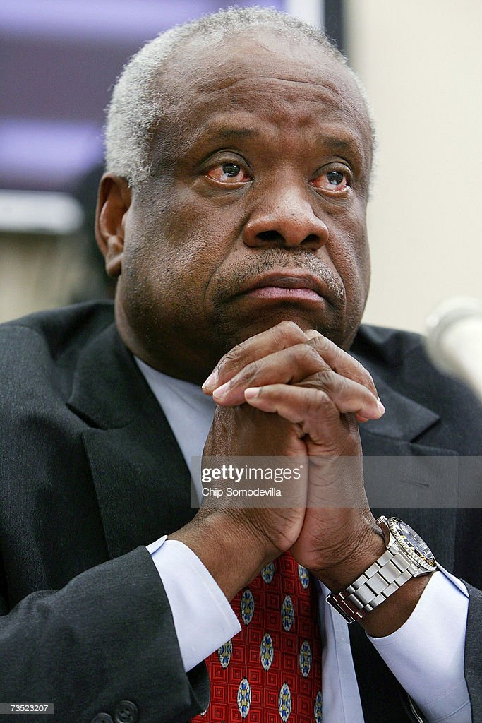 U.S. Supreme Court Justices <a gi-track='captionPersonalityLinkClicked' href=/galleries/search?phrase=Clarence+Thomas+-+Judge&family=editorial&specificpeople=217528 ng-click='$event.stopPropagation()'>Clarence Thomas</a> testifies before the House Financial Services and General Government Subcommittee on Capitol Hill March 8, 2007 in Washington, DC. Thomas and fellow Justice Anthony Kennedy spoke about concerns with the ongoing remodeling of the court building, the reduction of paperwork due to electronic media and the disparity of pay between federal judges and lawyers working in the private sector.
