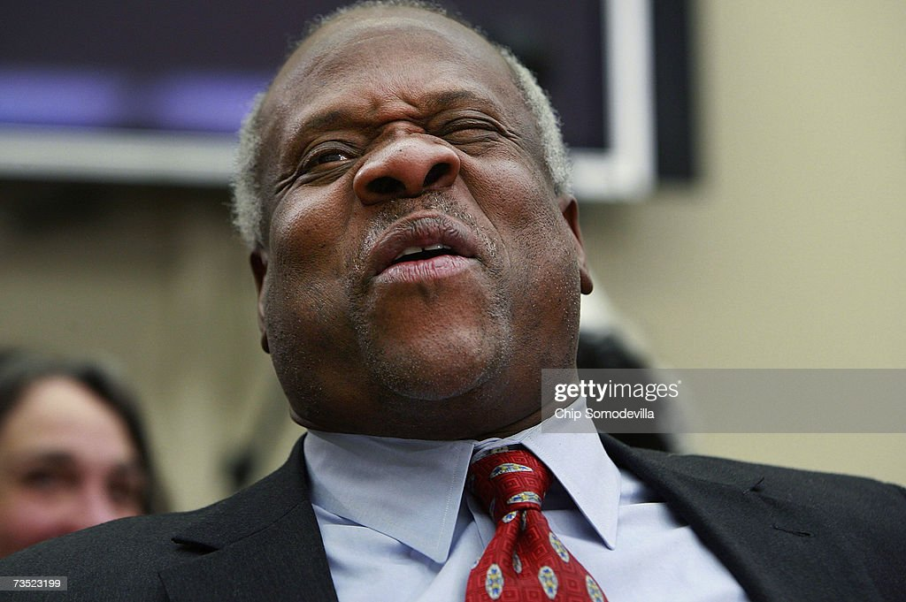 U.S. Supreme Court Justices <a gi-track='captionPersonalityLinkClicked' href=/galleries/search?phrase=Clarence+Thomas+-+Judge&family=editorial&specificpeople=217528 ng-click='$event.stopPropagation()'>Clarence Thomas</a> winces at a joke about baseball told between members of the House Financial Services and General Government Subcommittee while he testified before the subcommittee on Capitol Hill March 8, 2007 in Washington, DC. Thomas and fellow Justice Anthony Kennedy spoke about concerns with the ongoing remodeling of the court building, the reduction of paperwork due to electronic media and the disparity of pay between federal judges and lawyers working in the private sector.