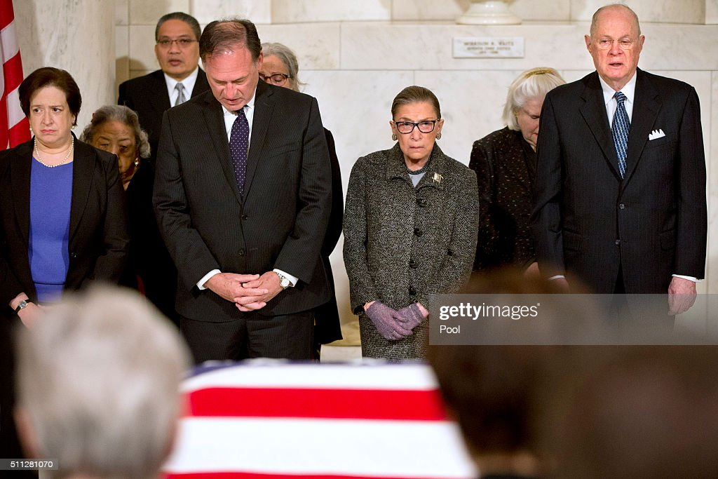 Supreme Court Justices <a gi-track='captionPersonalityLinkClicked' href=/galleries/search?phrase=Elena+Kagan&family=editorial&specificpeople=5704239 ng-click='$event.stopPropagation()'>Elena Kagan</a>, left, Samuel Anthony Alito, Jr., <a gi-track='captionPersonalityLinkClicked' href=/galleries/search?phrase=Ruth+Bader+Ginsburg&family=editorial&specificpeople=199152 ng-click='$event.stopPropagation()'>Ruth Bader Ginsburg</a>, and Anthony M. Kennedy react during prayers at a private ceremony in the Great Hall of the Supreme Court where late Supreme Court Justice Antonin Scalia lies in repose on February 19, 2016 in Washington, DC. Justice Scalia will lie in repose in the Great Hall of the high court where visitors will pay their respects.