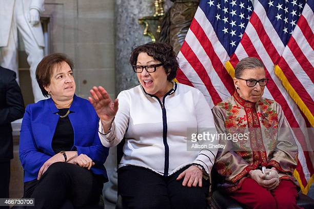 US Supreme Court justices Elena Kagan Sonia Sotomayor and Ruth Bader Ginsburg participate in an annual Women's History Month reception hosted by...