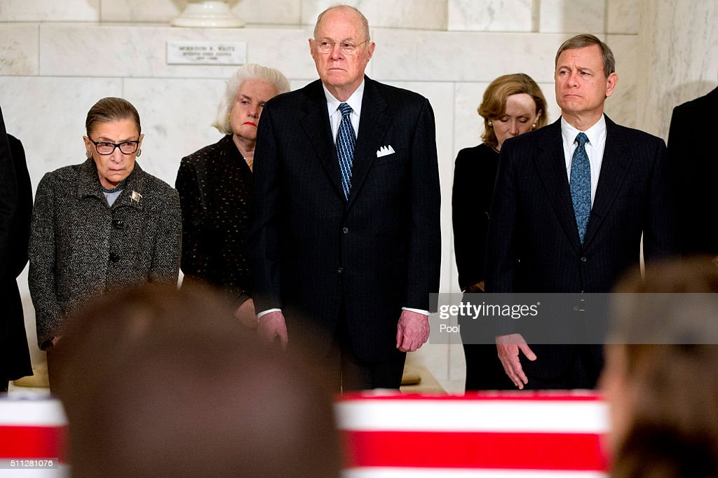 Supreme Court Justices Ruth Bader Ginsburg left Anthony M Kennedy and Chief Justice John G Roberts Jr attend a private ceremony in the Great Hall of...