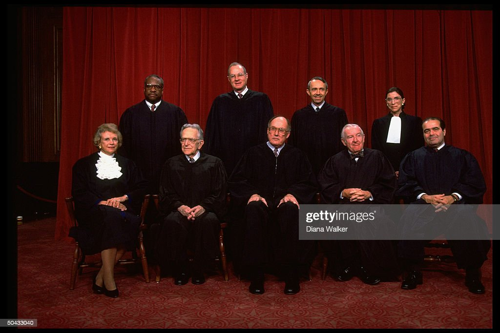 Supreme Court Justices Scalia Ginsburg Stevens Souter Chief Rehnquist Kennedy Blackmun Thomas O'Connor sitting for portrait