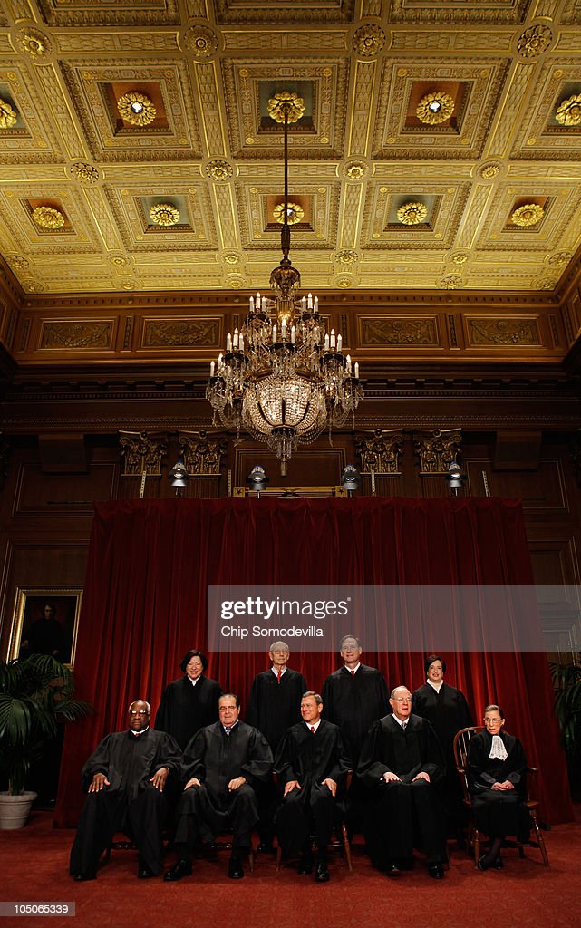 U.S. Supreme Court members (first row L-R) Associate Justice <a gi-track='captionPersonalityLinkClicked' href=/galleries/search?phrase=Clarence+Thomas+-+Judge&family=editorial&specificpeople=217528 ng-click='$event.stopPropagation()'>Clarence Thomas</a>, Associate Justice <a gi-track='captionPersonalityLinkClicked' href=/galleries/search?phrase=Antonin+Scalia&family=editorial&specificpeople=215620 ng-click='$event.stopPropagation()'>Antonin Scalia</a>, Chief Justice John Roberts, Associate Justice <a gi-track='captionPersonalityLinkClicked' href=/galleries/search?phrase=Anthony+Kennedy+-+Judge&family=editorial&specificpeople=220874 ng-click='$event.stopPropagation()'>Anthony Kennedy</a>, Associate Justice <a gi-track='captionPersonalityLinkClicked' href=/galleries/search?phrase=Ruth+Bader+Ginsburg&family=editorial&specificpeople=199152 ng-click='$event.stopPropagation()'>Ruth Bader Ginsburg</a>, (back row L-R) Associate Justice <a gi-track='captionPersonalityLinkClicked' href=/galleries/search?phrase=Sonia+Sotomayor&family=editorial&specificpeople=5872777 ng-click='$event.stopPropagation()'>Sonia Sotomayor</a>, Associate Justice <a gi-track='captionPersonalityLinkClicked' href=/galleries/search?phrase=Stephen+Breyer+-+Judge&family=editorial&specificpeople=227411 ng-click='$event.stopPropagation()'>Stephen Breyer</a>, Associate Justice <a gi-track='captionPersonalityLinkClicked' href=/galleries/search?phrase=Samuel+Alito&family=editorial&specificpeople=274708 ng-click='$event.stopPropagation()'>Samuel Alito</a> and Associate Justice <a gi-track='captionPersonalityLinkClicked' href=/galleries/search?phrase=Elena+Kagan&family=editorial&specificpeople=5704239 ng-click='$event.stopPropagation()'>Elena Kagan</a> pose for photographs in the East Conference Room at the Supreme Court building October 8, 2010 in Washington, DC. This is the first time in history that three women are simultaneously serving on the court.