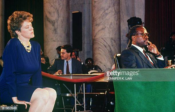Supreme Court nominee Clarence Thomas flanked by his wife Virginia waits to reopen his testimony 12 October 1991 before the Senate Judiciary...