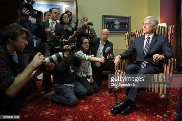 Supreme Court nominee Judge Neil Gorsuch faces members of the news media while meeting with Sen Joe Manchin in his office in the Hart Senate Office...