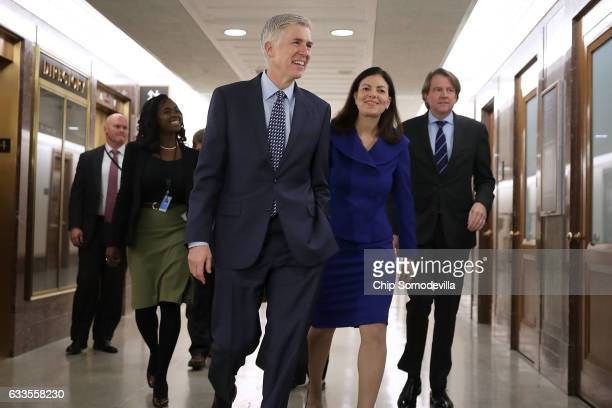 Supreme Court nominee Judge Neil Gorsuch is accompanied by former US senator Kelly Ayotte of New Hampshire as they arrive at the Dirksen Senate...