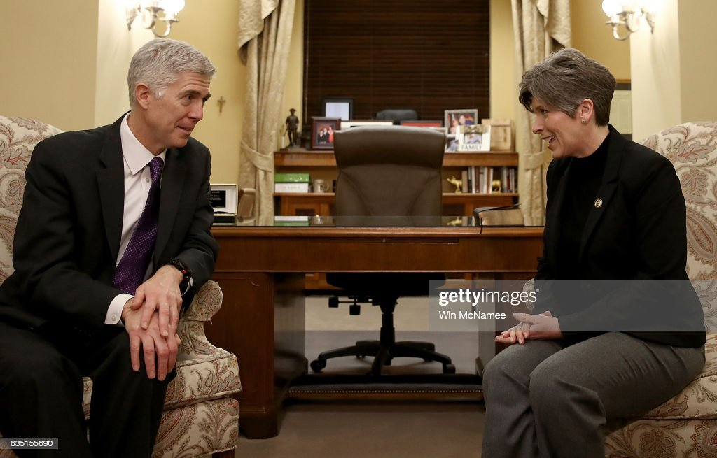 U.S. Supreme Court nominee Judge Neil Gorsuch (L) meets with Sen. Joni Ernst (R) (R-IA) in Ernst's office on Capitol Hill February 13, 2017 in Washington, DC. Gorsuch continues to meet with members of the U.S. Senate who are expected to take up his nomination in several weeks.